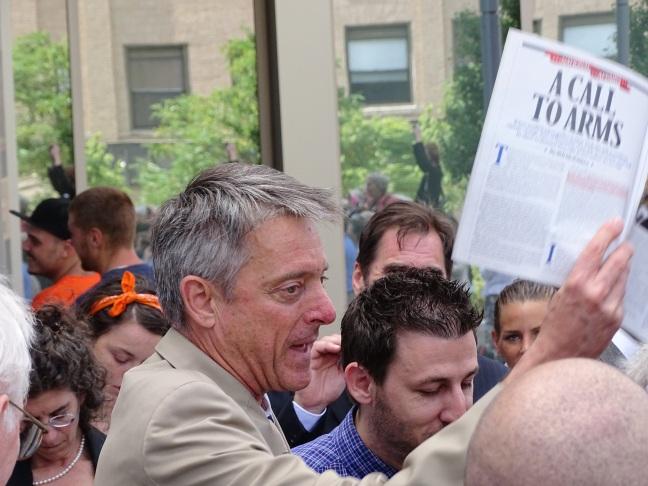 DA Sam Sutter holding Rolling Stone Magazine. Photo picked up nationally.