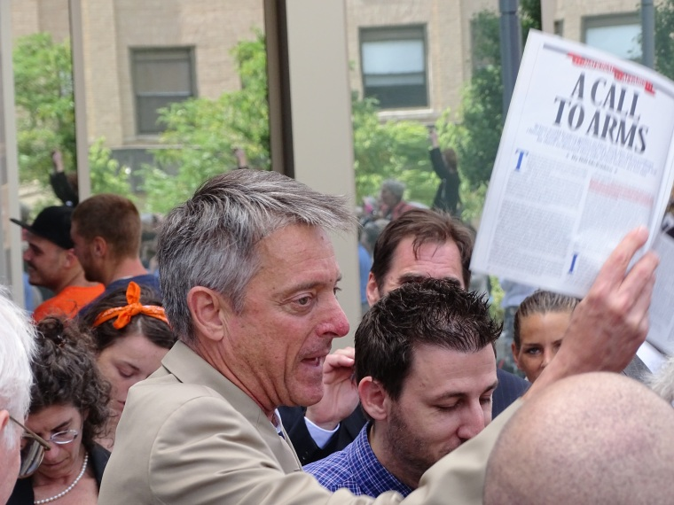 DA Sam Sutter holding Rolling Stone Magazine